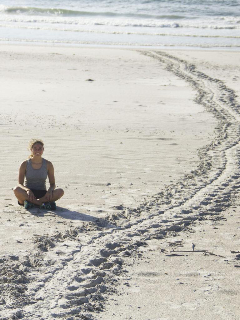 Callie Boatright with sea turtle tracks